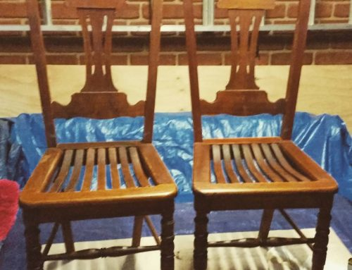 A pair of old oak chairs